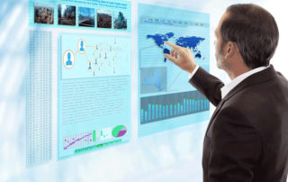 Man pointing at map and charts